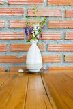 Flower in the white vase on the table Stock Photos