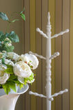 Flower and white wooden standing cloth rack Royalty Free Stock Images