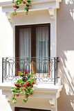 Flower window. Classic balcony and window with colorful flower stock image