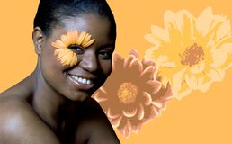 Flower Woman. Attractive young black woman with a gerbera daisy eye Stock Photo
