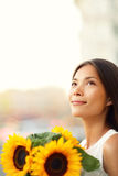 Flower woman holding sunflower smiling happy Stock Photos