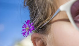 Flower on a woman& x27;s ear Royalty Free Stock Images