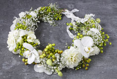 Flower wreath with carnations, orchids and gypsophila paniculata Royalty Free Stock Image