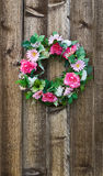 Flower wreath on fence Stock Photography