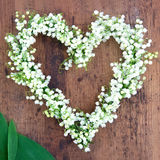 Flower wreath on rustic wooden background Royalty Free Stock Image