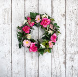 Flower wreath on vintage white background Stock Image