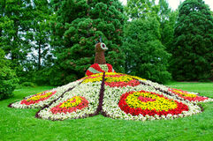 Flowerbed. Beautiful flowerbed and green lavn Royalty Free Stock Image