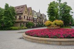 Flowerbed before European-style buildings Royalty Free Stock Image