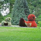 Flowerbed in figures ducks Royalty Free Stock Photos