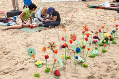 Flowerbed of paper flower on the beach Stock Image