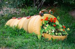 Flowerbed Sculpture of a caterpillar made of old automobile tires.  royalty free stock image