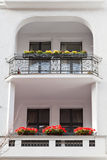 Flowerbeds at balcony residential house Stock Photography