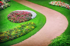 Flowerbeds. Blooming colorful flowerbeds in garden stock photos