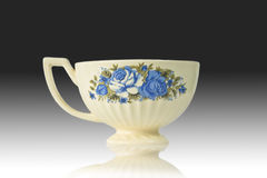 Flowered antique tea cup Stock Photos