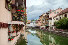 Flowered balconies at ancient buildings over a river, France Royalty Free Stock Photo