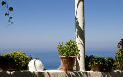 Flowered balcony on the Aegean Sea Royalty Free Stock Images