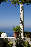 Flowered balcony on the Aegean Sea Stock Photos
