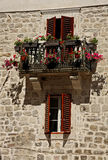 Flowered balcony in Kotor. Fortress, Montenegro Royalty Free Stock Images