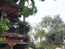 Flowered balcony in Villa de Leyva, Colombia while it rains stock photo