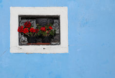 Flowered balcony with a window in the house and many flower pots. Beautiful flowered balcony with a window in the house and many flower pots stock photos