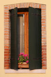 flowered balcony with a window in the house and many flower pots Stock Images