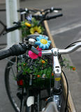 Flowered bike. A parked bike with plastic flowers Stock Photography