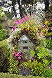 Flowered Birdhouse Stock Photo
