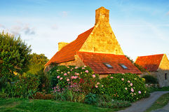 Flowered cottage in Brittany. Traditional house in stone with flowers in Brittany, France stock images