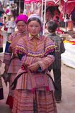 Flowered Hmong Woman. Girl Hmong flowered in market of Can Cau. The market is held weekly appointment for the young. Families were isolated in the mountains and Royalty Free Stock Images
