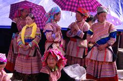 Flowered Hmong women's group. Group of women at Bac Ha market in conversation. The market is the single point of reunion of these ethnic groups scattered in Stock Photography