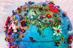 Flowered india. India as seen from Space , globe with plasticine flowers royalty free stock photo