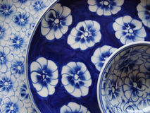 Flowered plates and bowl Royalty Free Stock Photos