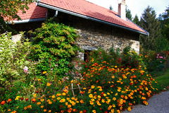 Flowered stone house Royalty Free Stock Images