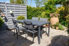 Flowered terrace with garden furniture royalty free stock photography