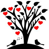 Flowered tree heart with songbird Stock Images