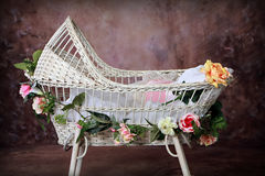 Flowered Wicker Baby Bassinet. Antique Wicker Bassinet Photography Digital Prop adorned with flowers. can be edited as to place an image of a child within stock photos