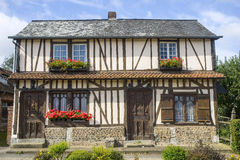 Flowered window of old house in Normandy Royalty Free Stock Photography