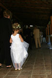 Flowergirl. Flower girl waiting for bride royalty free stock image