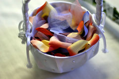 Flowergirl basket. A basket full of petals for a flowergirl at a wedding Stock Image