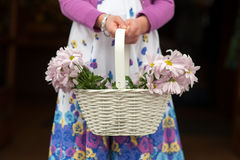 Flowergirl with basket of flowers at a wedding. Flowergirl with basket of chrysanthemum flowers at a wedding Royalty Free Stock Photos