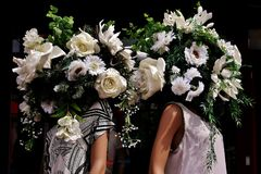 Two ladys with flower heads. Stock Images