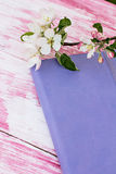 Flowering apple-tree with a notebook. The sprigs of flowering apple-tree with a notebook Stock Images
