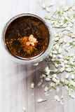 Flowering Tea and Dry Flowers on Wooden Background Stock Image