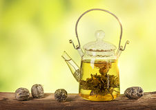Flowering tea in a teapot. On a wooden table stock photography