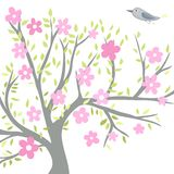 Flowering tree with a bird Stock Photo