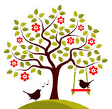 Flowering tree and birds Royalty Free Stock Image
