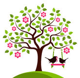 Flowering tree and birds Stock Image