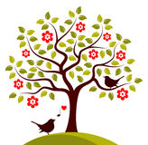 Flowering tree and love birds Royalty Free Stock Photo
