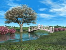 Flowering Tree and Pink Bridge. Flowering tree, bushes, and pink bridge over small river in spring royalty free stock photos