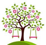Flowering tree with swings Stock Photo